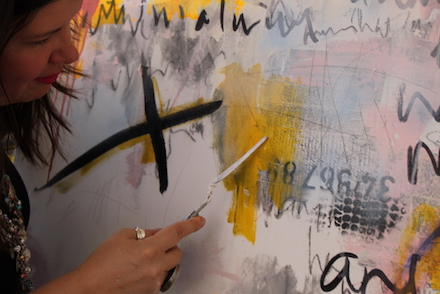 Lorette C. Luzajic at work on a painting, 2019