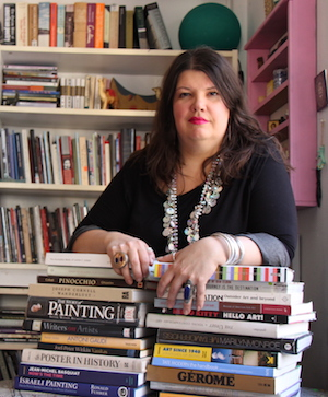 Lorette C. Luzajic, with books