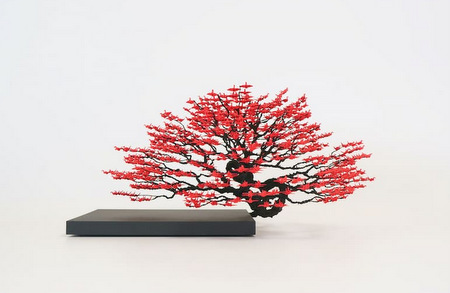 Tree sculpture with leaves of red origami cranes by Naoki Onogawa
