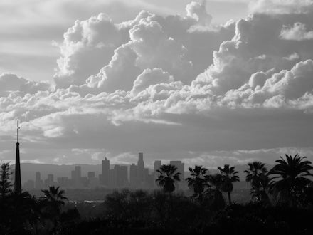 Clouds and Downtown Los Angeles Skyline: B&W photograph by Jonathan Yungkans